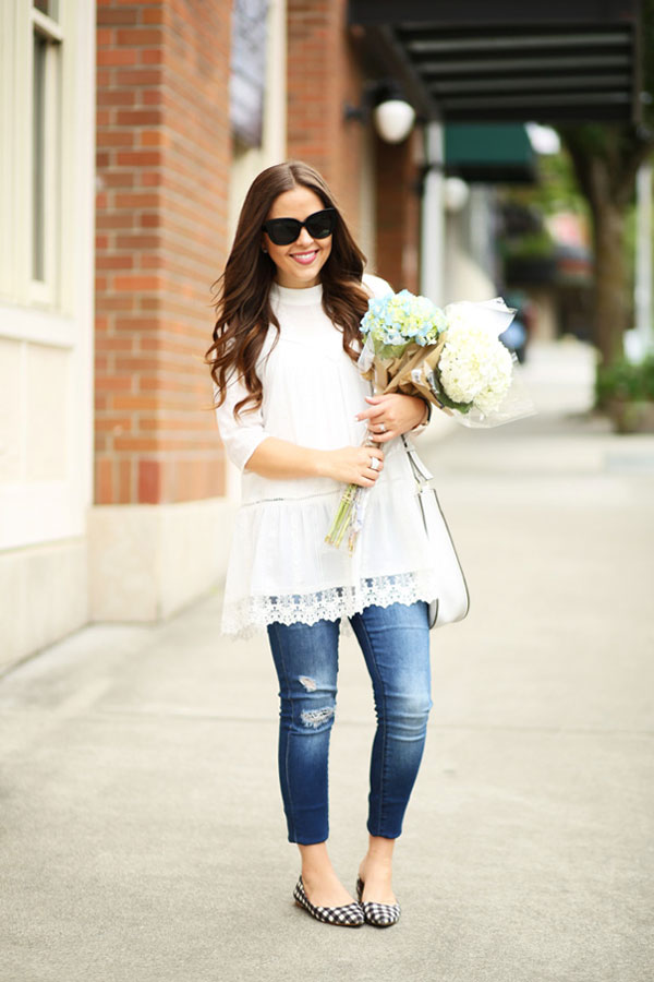 a32486a514 The subtly flared trousers with button detailing on the pockets are the  perfect length to wear with high-heeled white sandals. A white satchel  further pulls ...
